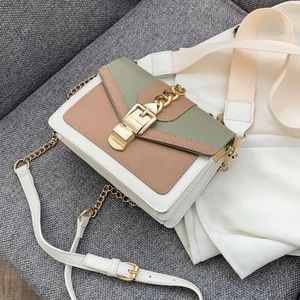 Neutral colored Satchel white thick strap